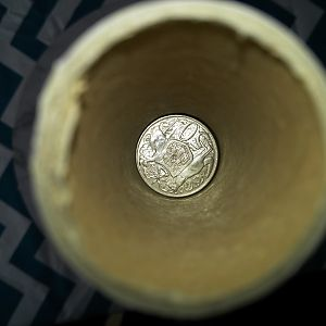 Coin in roll upright